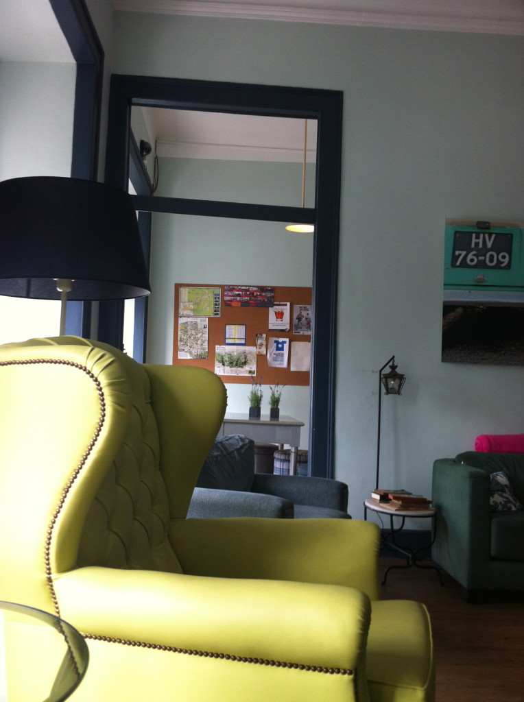 Beautiful upholstered leather chairs in the common room of the hostel