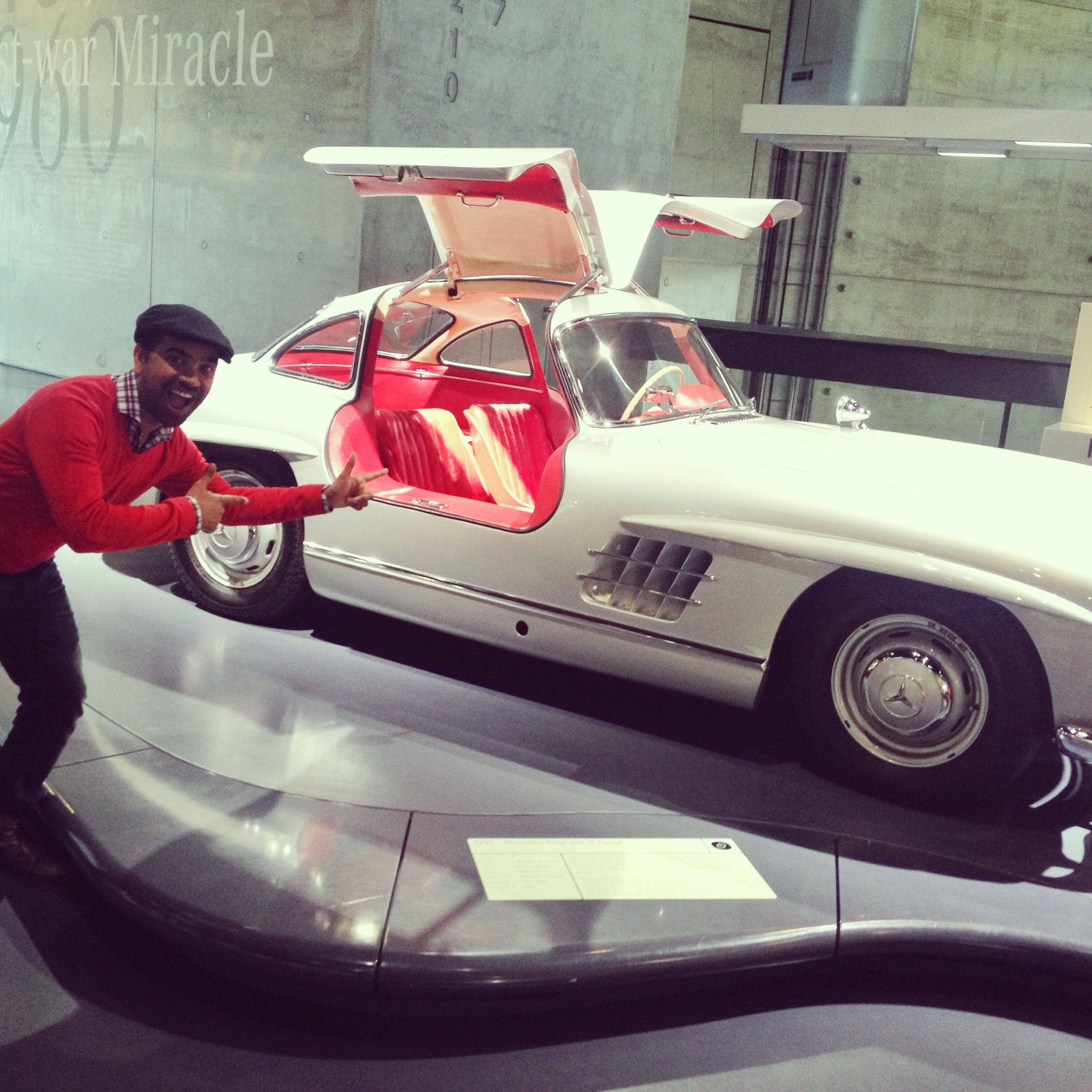 Me in front of the Mercedes 300 Coupe at the Mercedes Benz Museum