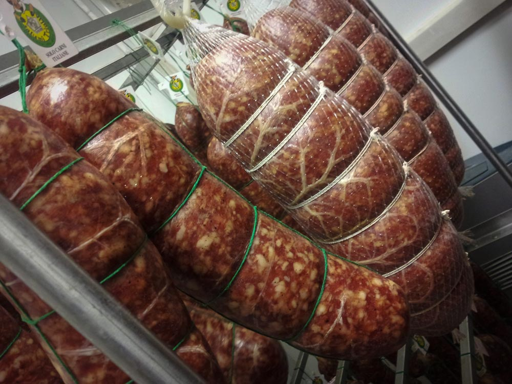 Salami and cured meats hanging in Italian Butchery, Gombitelli