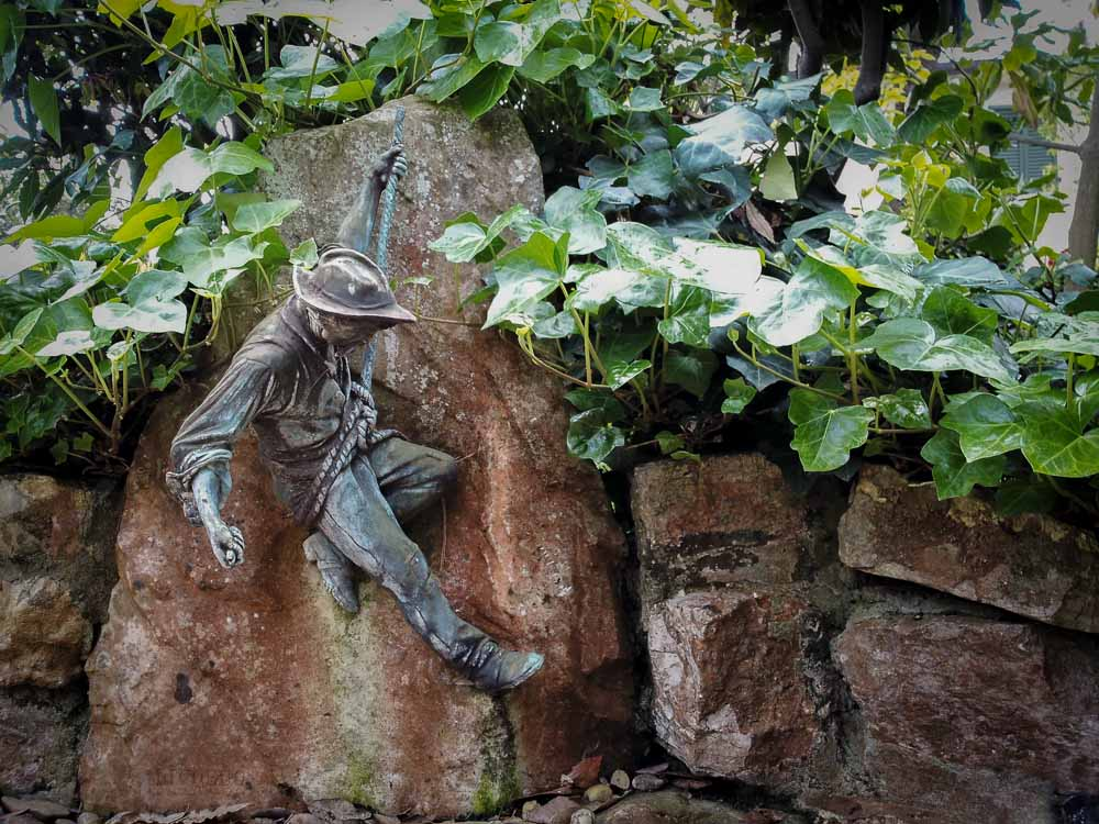 Brass figurine in the garden of Villa Puccini Tuscany