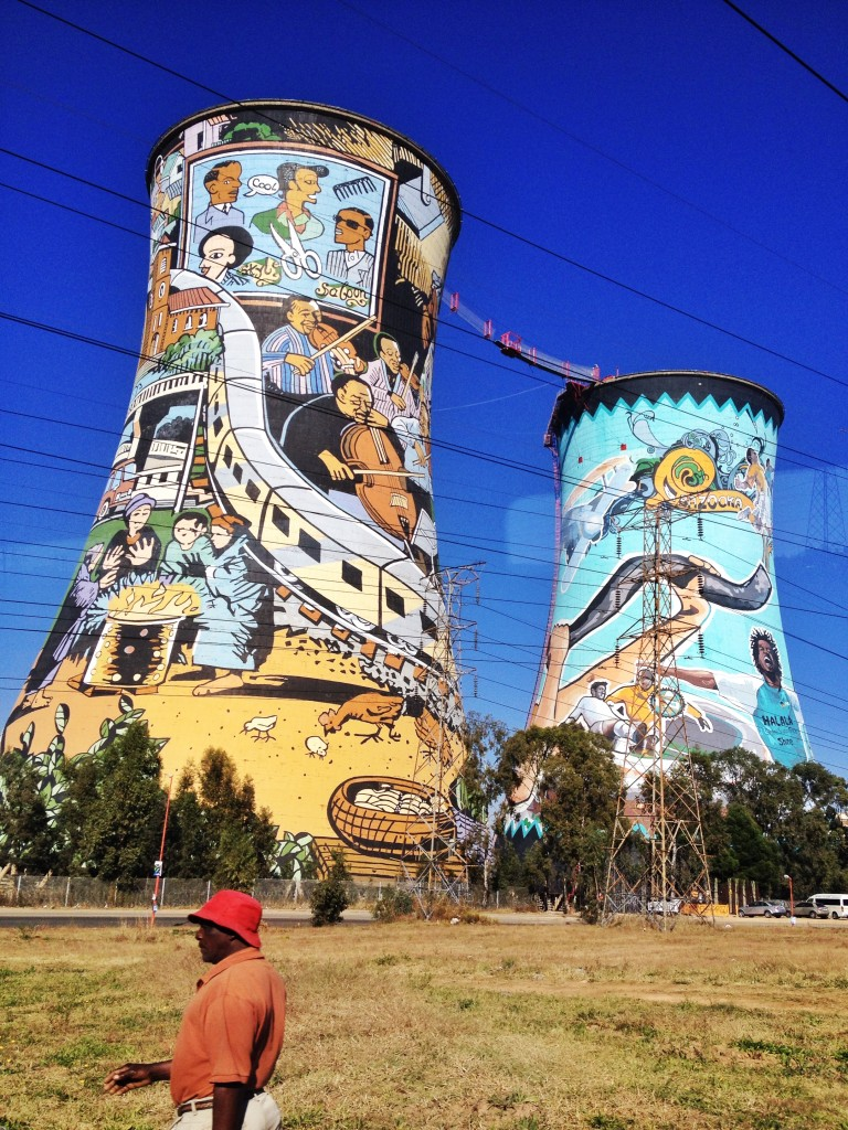 Orlando Towers- formerly a decommissioned coal fired power station in Soweto, South Africa,the twin water cooling towers are now home to the largest mural painting in South Africa and also serves as a bungee +base jump platform.