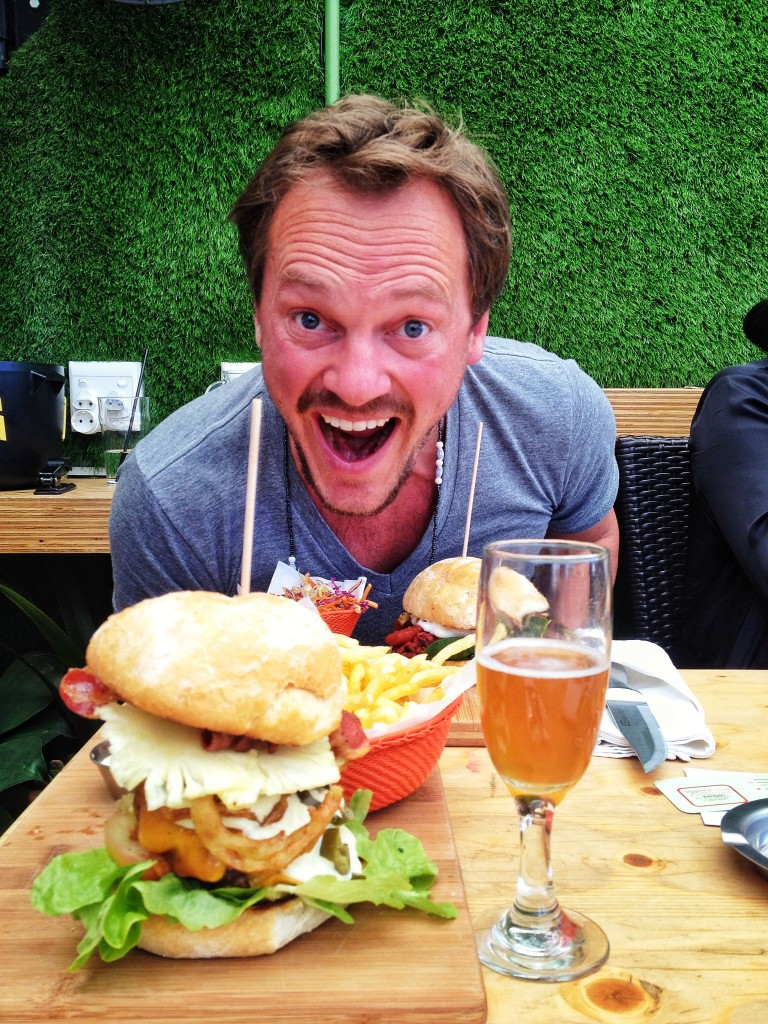 This is Casper,savouring his gourmet beef burger at the Wolfpack-situated on Parkhurst's 4th avenue , this bar draws in a nice mix of locals and tourists with their winning combo of craft beer and gourmet burgers.