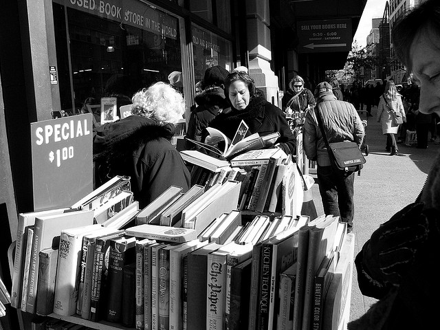 Browsing the bargains at the biggest bookstore in the USA: Strand Bookstore, New York. Photo by Kathleen Tyler Conklin and sourced via Creative Commons