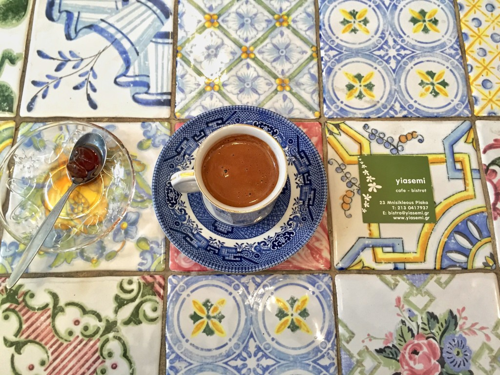Breakfast in Athens at cafe, bistrot. Yiasemi. Thick medium sweet Greek coffee with grapes in syrup. They do a fabulous range of pies ( tart with eggplant, feta & basil for eg) for just €5