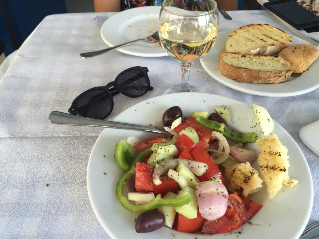 Happiness is dipping bread into a delicious Greek salad. Take me back to Athens right now!