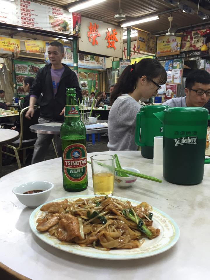 Cuilnary extravaganza continues somewhere in Temple Street: Tsingtao beer.Stir fried rice noodles with pork, Chinese broccoli & soy sauce.