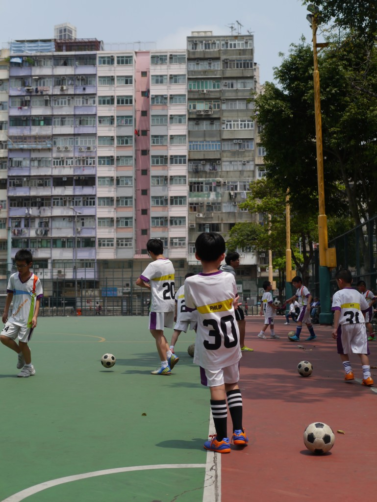 Despite the high concentration of buildings, there are plenty of open wide green spaces, parks and artificial pitches like this where local kids are being trained to become the next football stars of the nation.