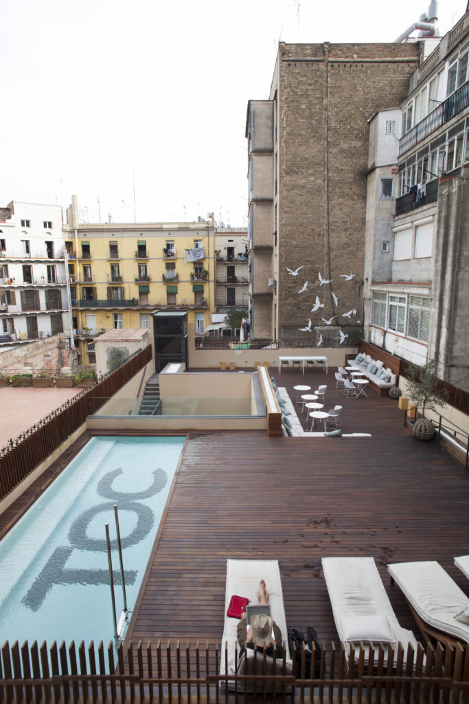 A Hostel With An Outdoor Swimming Pool In Barcelona