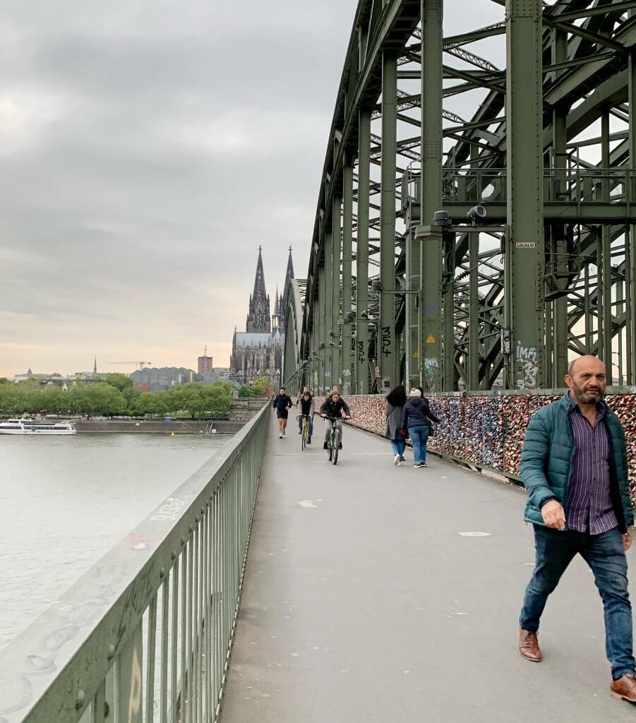The moment you walk across the Hohenzollernbrücke and the twin spires of Cologne come into sight